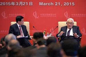 Kissinger addresses the Economic Development Forum in China last week